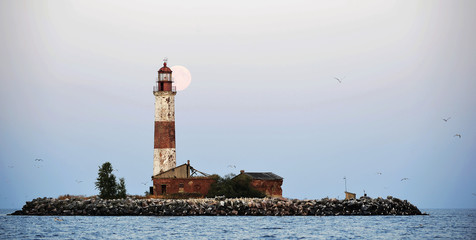 Moon and Old lighthouse