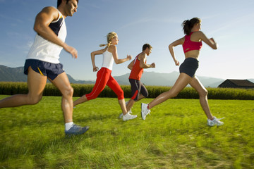 Men and women jogging.