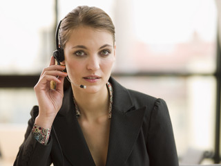 A young businesswoman talking on the headset.