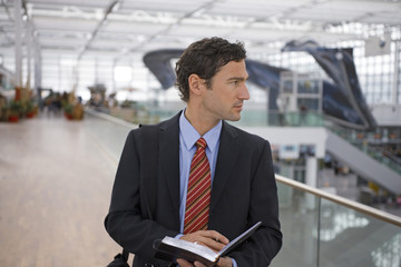 A businessman at an airport.