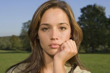 A teenage girl looking upset.