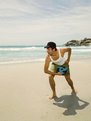 Man playing frisbee on the beach.