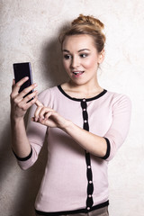 Businesswoman texting reading sms on smartphone