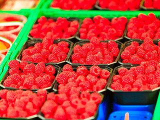 Raspberries in containers for sale at market place