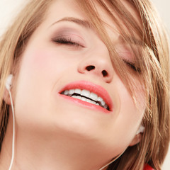 Girl with white headphones listening to music