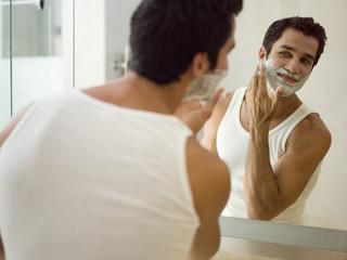 A man applying shaving foam.