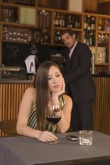 Man looking at a woman at a restaurant.