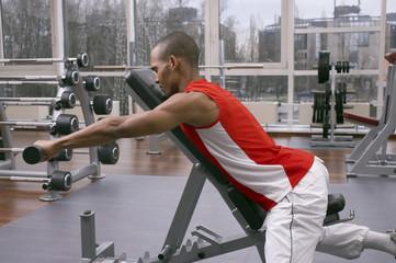 Man lifting weights at a gym.
