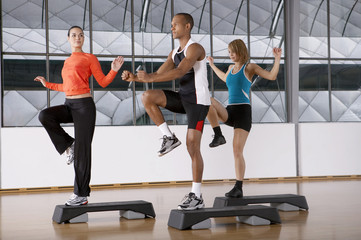 People doing step aerobics.
