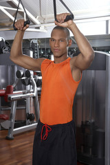 Man exercising in a gym.