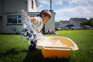 Boy playing with water