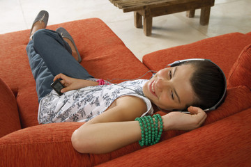 Girl listening to her music player.