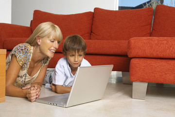 Mother and son with a laptop.