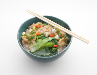 Chinese noodle soup with pork and spinach