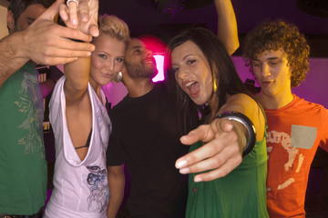 Five people dancing in a nightclub