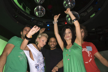 Low angle view of five people dancing in a nightclub