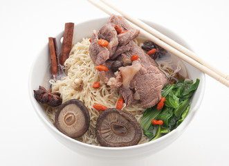 Noodle soup with pork, barberry and mushrooms