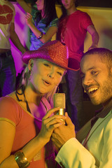 Portrait of a young couple singing in a nightclub