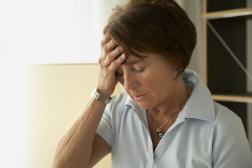 Close-up of a mature woman with a headache