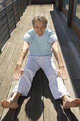 Portrait of a mature man exercising