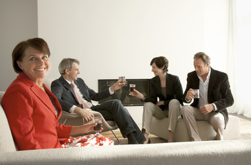 Four people sitting on couch