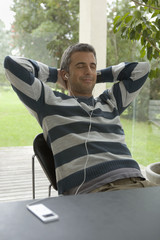 Man relaxing listening to MP3 player