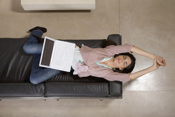 Woman lying down with laptop computer
