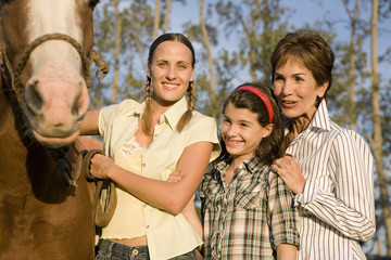 Three generation family with horses