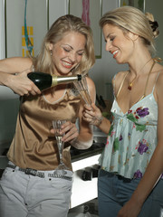 Two young women with champagne