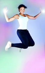 Smiling brunette woman jumping