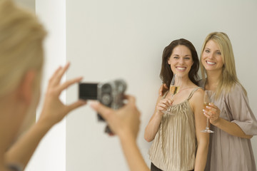 Woman taking photo of her friends