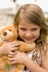 Portrait of a girl with teddy bear