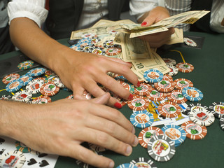 Detail of poker chips and money