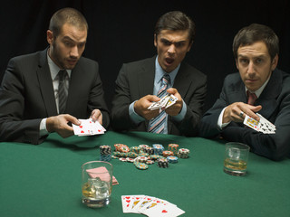 Upset men playing poker