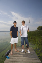 Young men with fishing pole