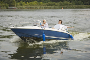 Father and son in boat on the lake