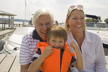 Grandparents and grandson at the lake