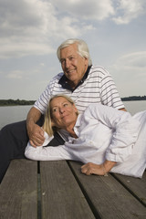 Senior couple relaxing at the lake