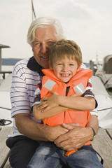 Grandfather and grandson at the lake