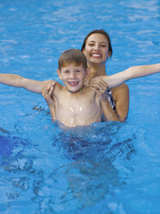 Mother and son playing in pool