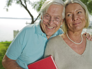 Portrait of senior couple near lake