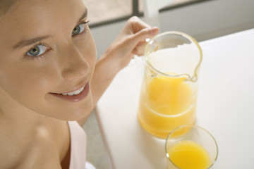 Close-up of woman with orange juice