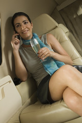Businesswoman sitting in a private airplane
