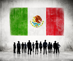 Silhouettes of Business People Looking at the Mexican Flag