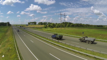 highway with cargo and automobile cars. Аerial