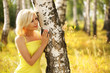 Blonde Woman at Birch Forest. Beautiful Smiling Girl Outdoor