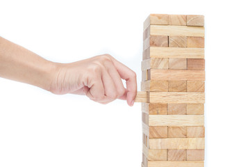 Hand playing with the wood game (jenga). isolate on white backgr