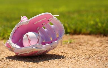 Baseball in Pink Female Glove on Field
