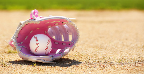 Baseball in Pink Female Glove on Field