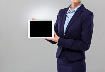 Businesswoman show the blank screen of digital tablet